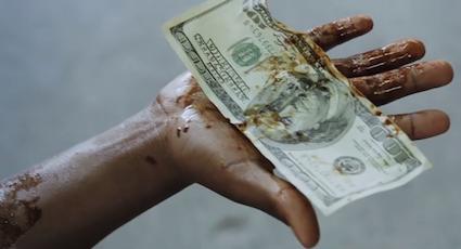oil_money_hand